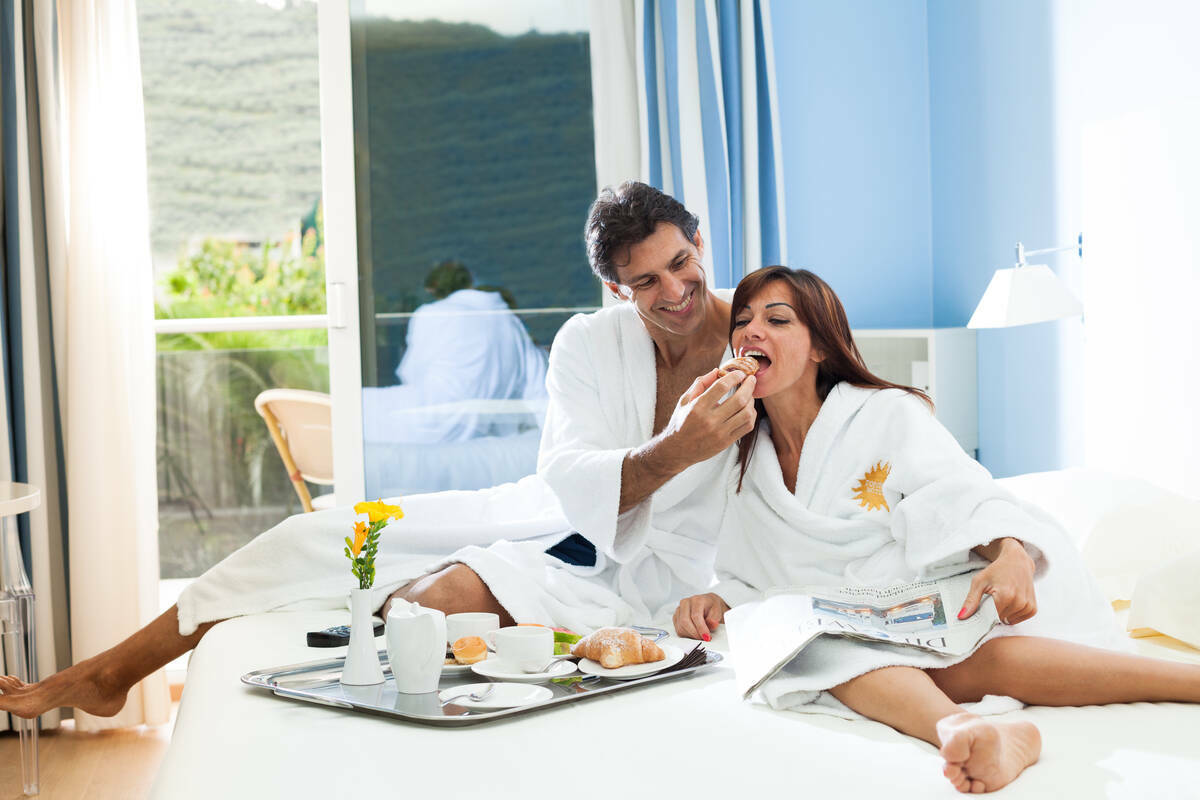 Couple having breakfast in the room