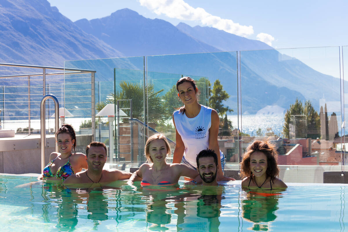 People in the pool with aquagym teacher